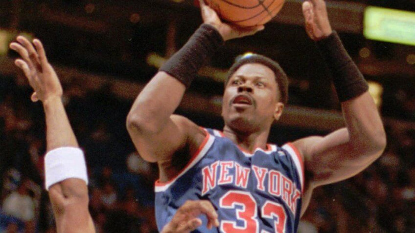 PATRICK EWING New York Knicks center Patrick Ewing (33) shoots over Michael Cage of the Cleveland Cavaliers during the Knicks' 94-84 win, in Cleveland.