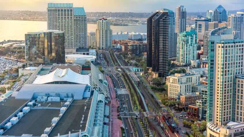 Aerial view of Harbor Drive flanked by highrise hotels and condominiums to the right and the San Diego Convention Center, home to Comic Con, to the left.
