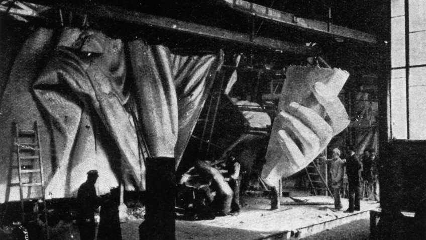circa 1884:  The left hand of the Statue of Liberty under construction.
