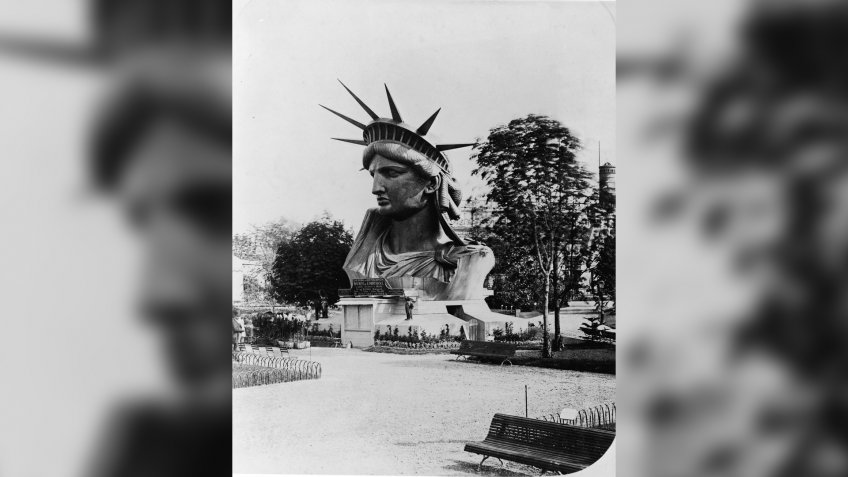 The head of the Statue of Liberty on display in the garden at the Champ de Mars at the World's Fair in Paris to drum up support and contributions for the completion of the great project, 1878.