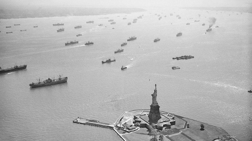 Labor unions; strikes; commerce Merchant ships lie at anchor in front of the Statue of Liberty in New York Harbor, .