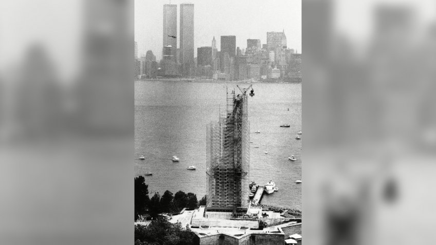 National monuments; New York Harbor; scaffolding The torch dangles above the Statue of Liberty after it was removed from her grasp in New York, .