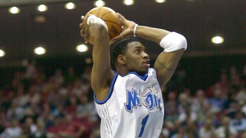MOHAMMED MCGRADY VAUGHN Orlando Magic's Tracy McGrady prepares to dunk the ball in the first period as Atlanta Hawks' Nazr Mohammed, left, defends and Hawks' Jacque Vaughn looks on in Orlando, FlaHAWKS MAGIC, ORLANDO, USA.