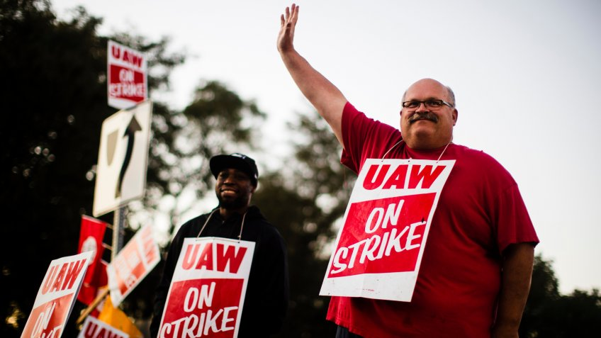 Mandatory Credit: Photo by Matt Rourke/AP/Shutterstock (10447513a)Workers Omar Glover, left, and Ray Gaeth picket outside a General Motors facility in Langhorne, Pa.