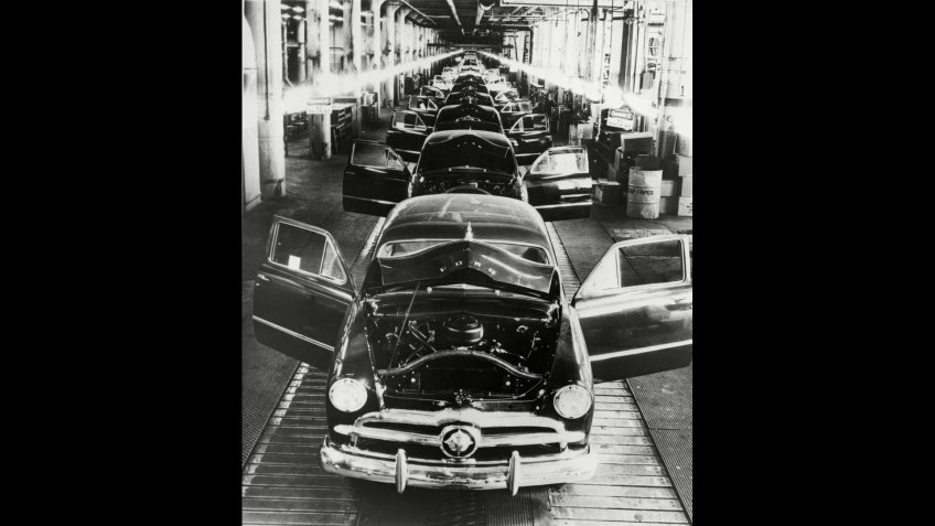 Mandatory Credit: Photo by Everett/Shutterstock (10288404a)1949 Ford cars sit on a deserted assembly line during the 25 day strike called by the United Auto Workers to oppose Henry Ford IIs imposition of automation and more efficient production standards.