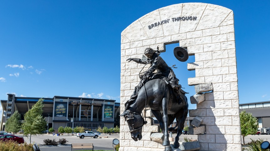 "Laramie, WY, USA - September 28, 2019: ""Breakin' Through"" Bronze Statue at War Memorial Stadium at the University of Wyoming."