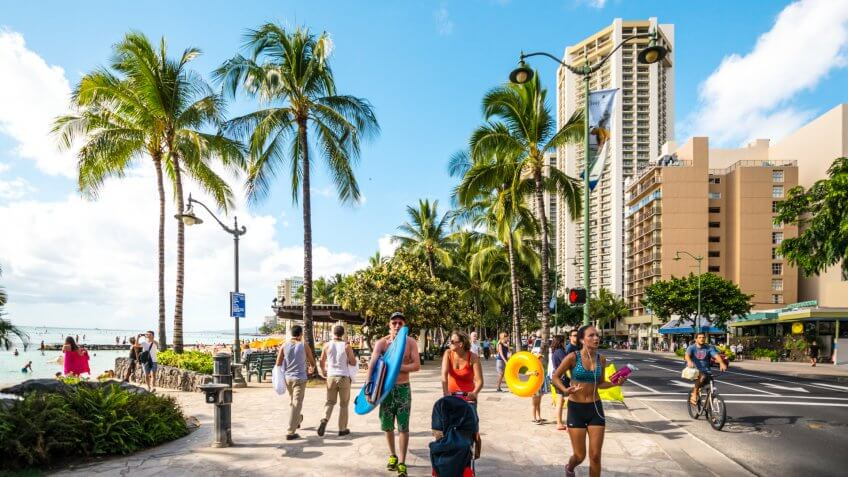 Waikiki, Hawaii, USA  - January 5, 2014: People jogging, cycling and walking along Waikiki Beach.