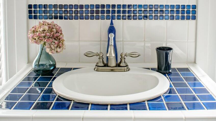 brushed nickel sink in bathroom