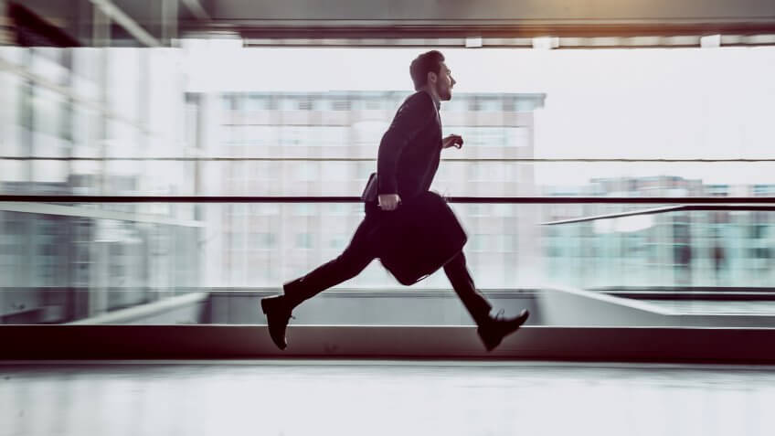 Businessman Running Across The Corridor.