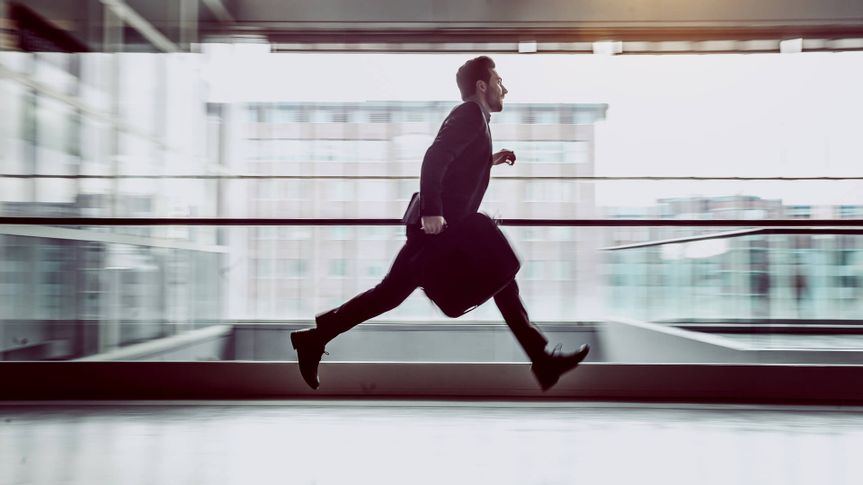 Businessman Running Across The Corridor.