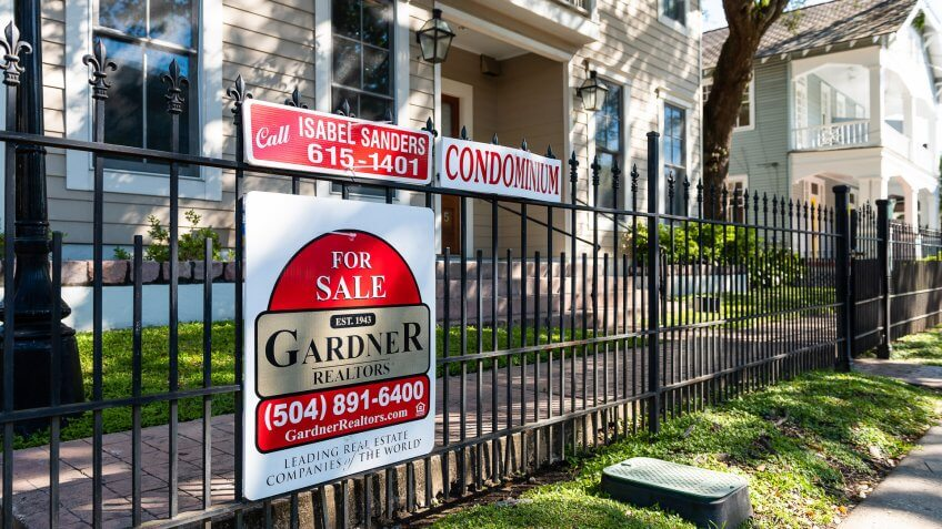 New Orleans, USA - April 23, 2018: Real estate for sale sign by realtor broker of apartment condominium in Garden district of Lousiana city.