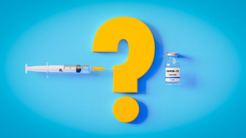 COVID-19 vaccine bottle, yellow question mark and syringe on blue background, Horizontal composition with copy space.