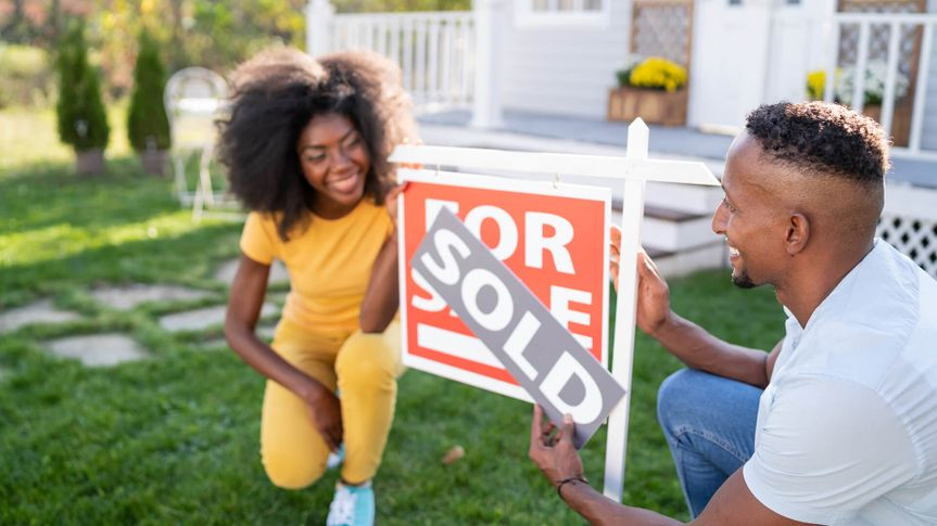 Young couple buying a new house.