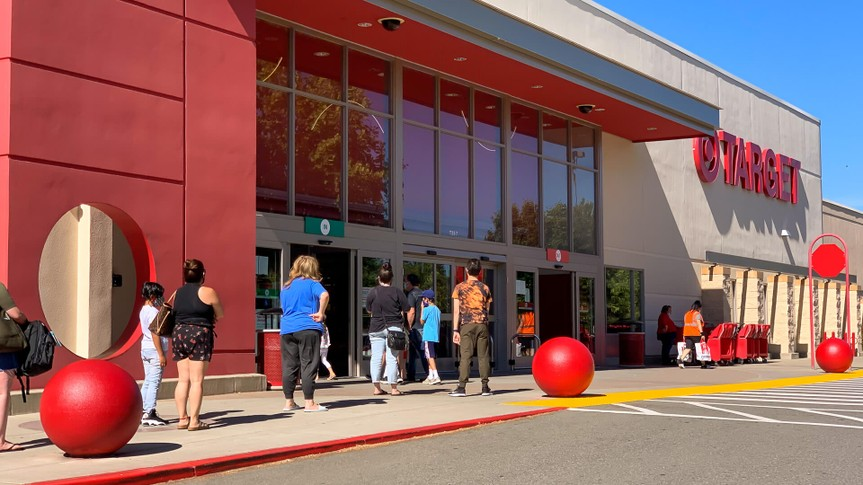customers wait in line outside of target