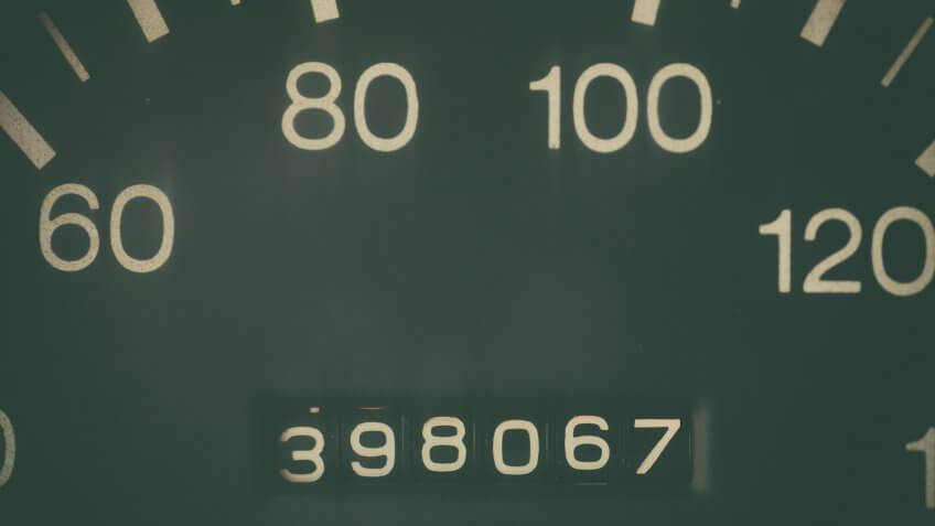 Car odometer showing a very high mileage.