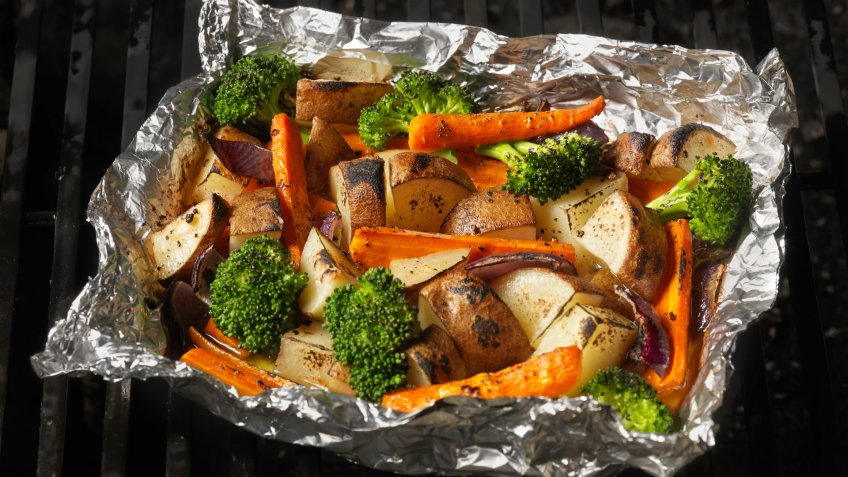 Cooked Vegetables in Tinfoil on the BBQ Grill -Photographed on Hasselblad H3D-39mb Camera.