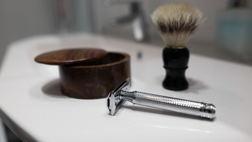 Shaving accessories in bathroom.