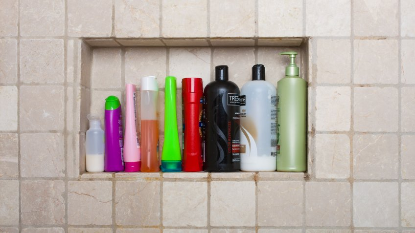 Bayonne, New Jersey, USA- September 16, 2013: Shampoos conditioners and liquid soaps in shower in wall of shower.