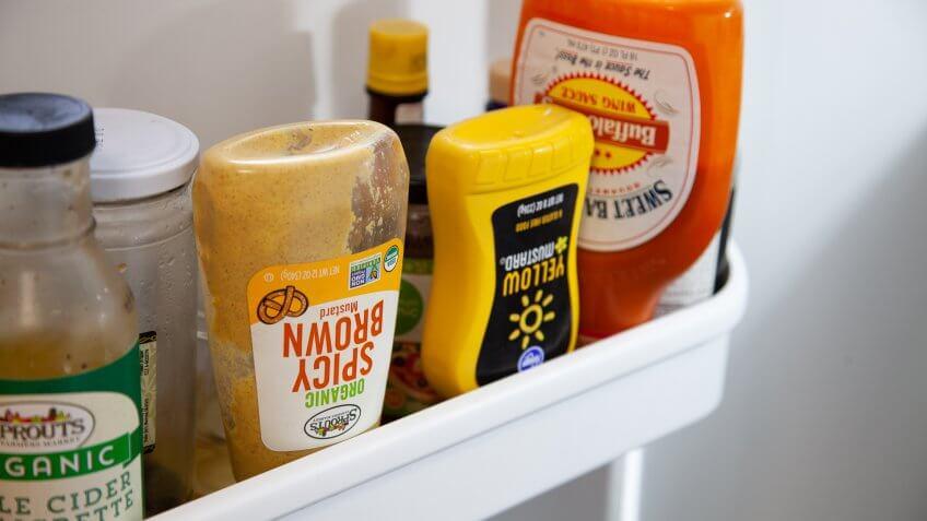 upside down condiments in refrigerator.