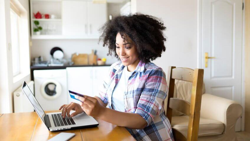 Woman looking at her credit card APR