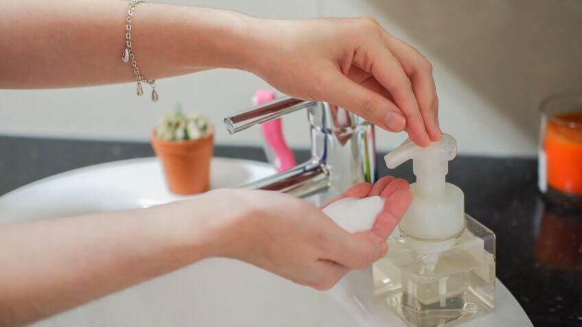 woman using foam soap pump