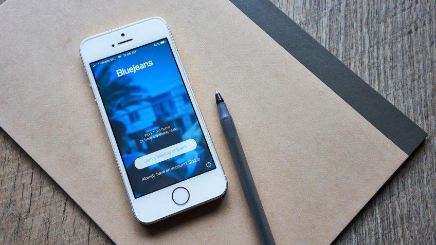 Portland, OR, USA - Mar 27, 2020: BlueJeans mobile app login screen is seen on a smartphone.