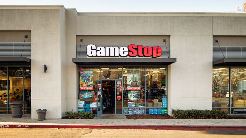 Gamestop video games store entrance facade in strip mall with sign, photographed in San Jose, California on boxing day.