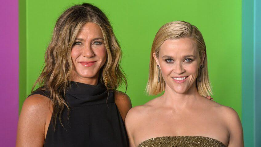 """NEW YORK, NY - OCTOBER 28: Actresses Jennifer Aniston and Reese Witherspoon attend Apple TV+'s """"The Morning Show"""" World Premiere at David Geffen Hall on October 28, 2019 in New York City."""