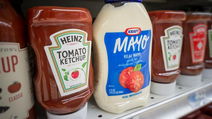 New York NY/USA-August 10, 2015 Bottles of Kraft Heinz mayonnaise and ketchup on a supermarket shelf in New York.