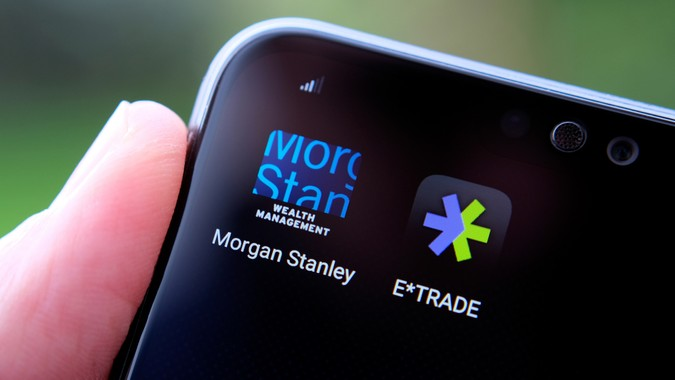 Stone / United Kingdom - February 23 2020: Morgan Stanley and E*TRADE apps seen on the smartphone screen hold in a hand.