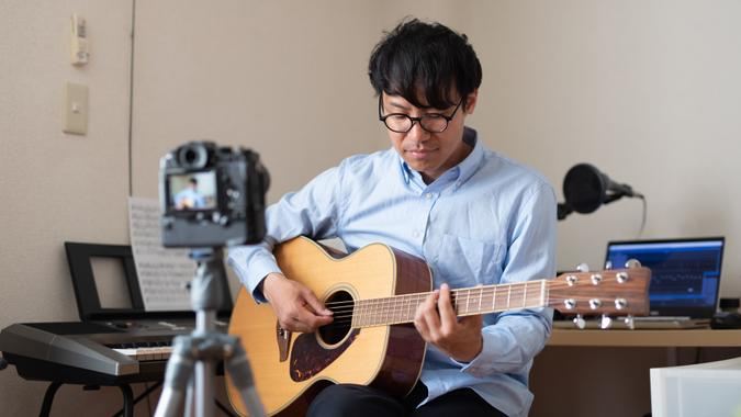Singer, You Tuber, broadcasting his performance at home.