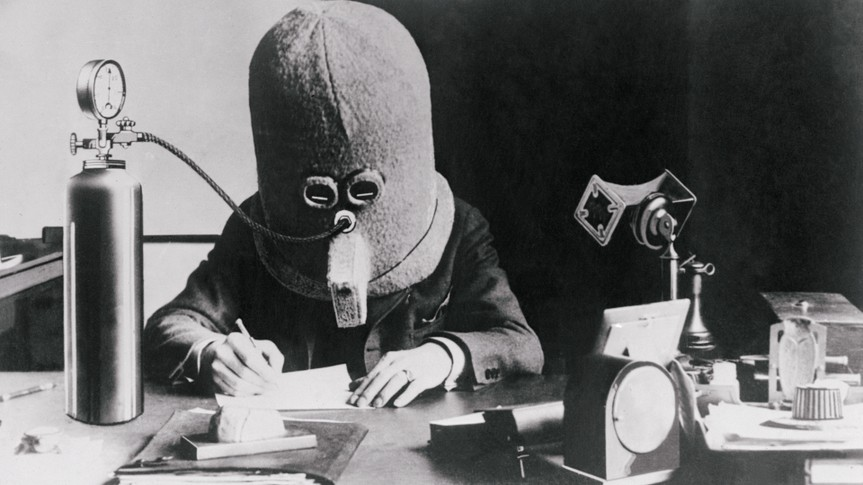 "(Original Caption) New York, New York: Here is a pictured Hugo Gernsbach, wearing what he calls his ""isolator,"" an invention that kills noise."
