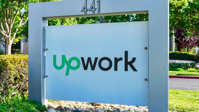 UpWork sign and logo near global freelancing platform company headquarters in Silicon Valley - Mountain View, California, USA - May 29, 2019.
