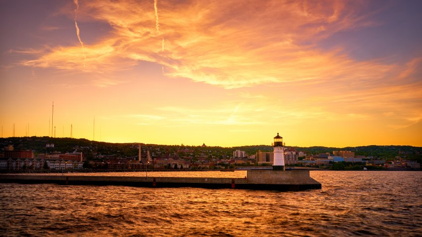 Beautiful sunset at Duluth Canal Park Lighthouse with the background of Duluth Downtown.