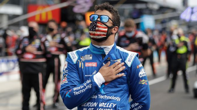 Mandatory Credit: Photo by Darron Cummings/AP/Shutterstock (10702659cl)Cup Series driver Bubba Wallace (43) stands during the national anthem before a NASCAR auto race at Indianapolis Motor Speedway in IndianapolisNASCAR Auto Racing, Indianapolis, United States - 05 Jul 2020.