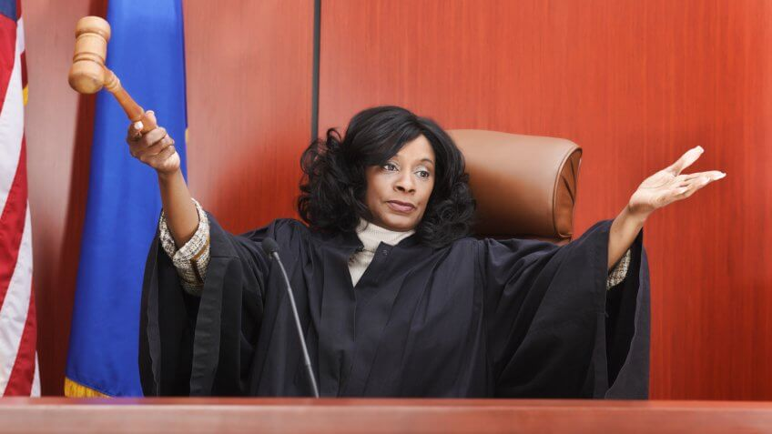 An African American female judge in the courtroom.