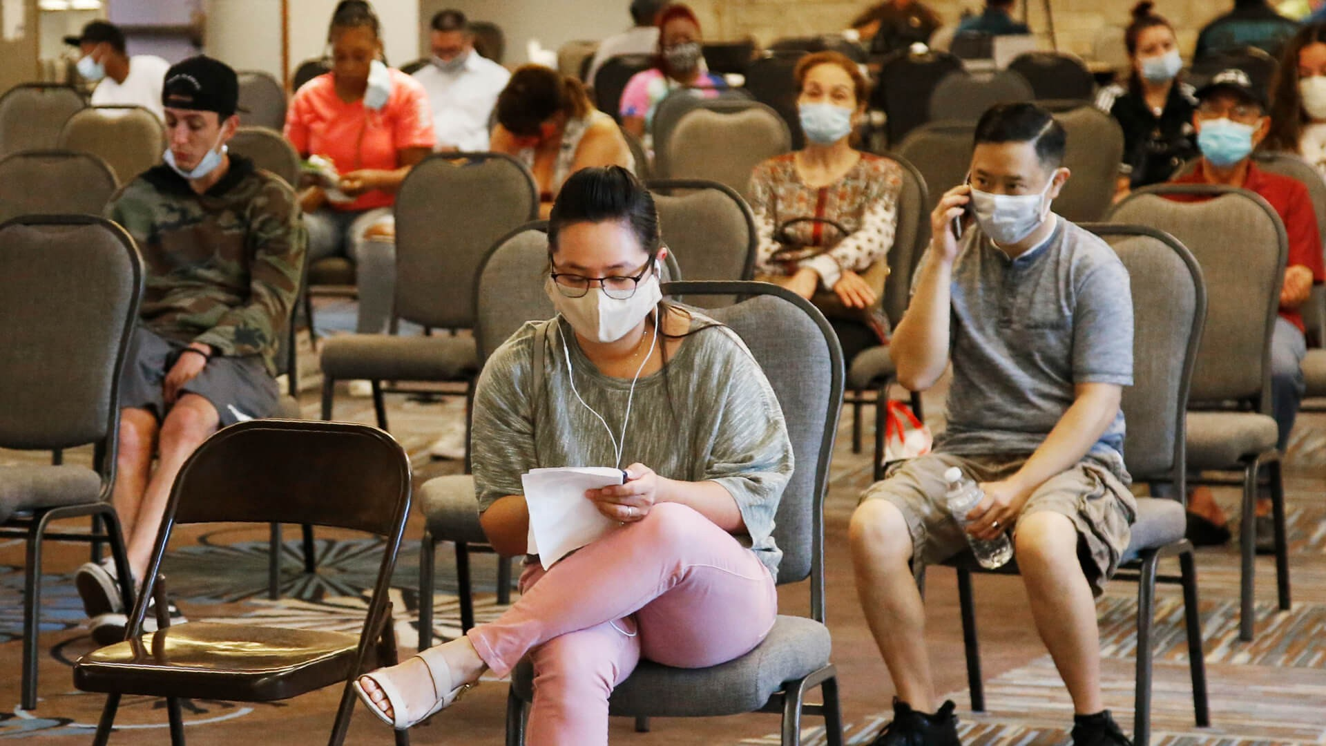 Mandatory Credit: Photo by Sue Ogrocki/AP/Shutterstock (10706877b)People wait to speak with representatives from the Oklahoma Employment Security Commission about unemployment claims, in Midwest City, Okla.