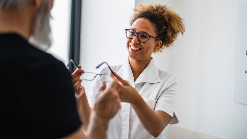 Portrait of a young female doctor talking to her client about eyesight.