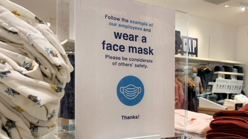 Phoenix, Arizona, June 18, 2020: Face Mask Sign in a Gap Retail Store during the reopening of stores during the Covid 19 Pandemic.