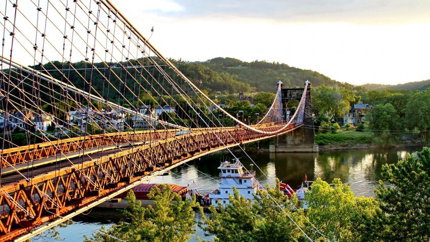 Large boat going under the suspension bridge at Wheeling, West Virginia.