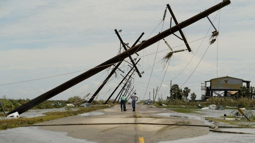 Mandatory Credit: Photo by Eric Gay/AP/Shutterstock (10757636n)People survey the damage left in the wake of Hurricane Laura, in Holly Beach, LaTropical Weather Louisiana, Holly Beach, United States - 27 Aug 2020.