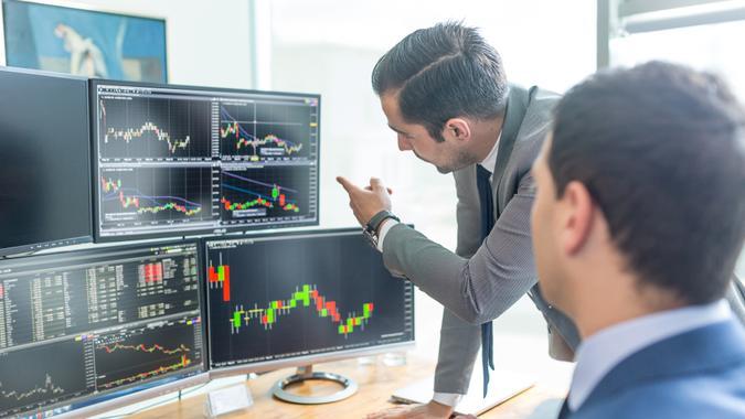 Businessmen Analyzing Stock Charts Online