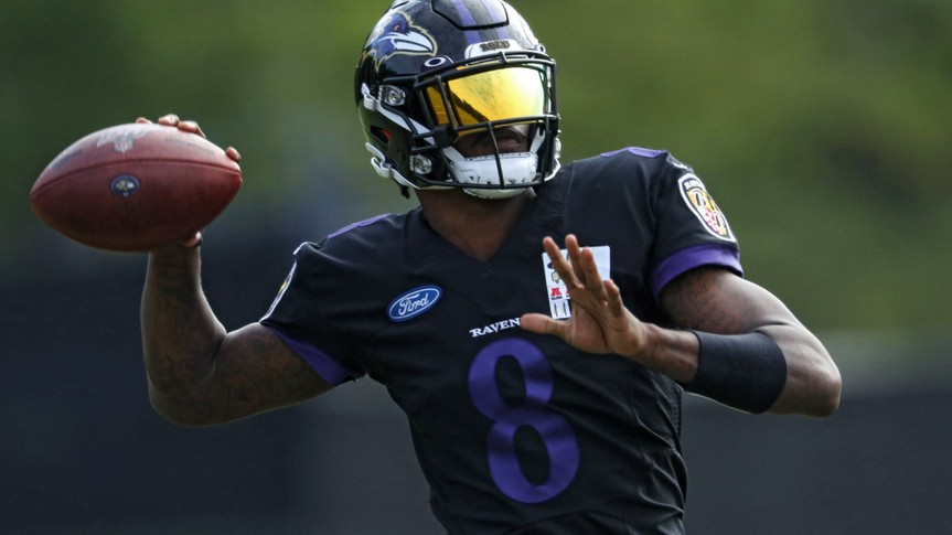 OWINGS MILLS, MARYLAND - AUGUST 17: Quarterback Lamar Jackson #8 of the Baltimore Ravens throws a pass during the Baltimore Ravens Training Camp at Under Armour Performance Center Baltimore Ravens on August 17, 2020 in Owings Mills, Maryland.