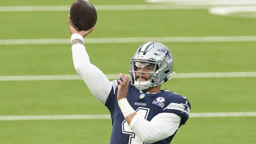 Mandatory Credit: Photo by Ashley Landis/AP/Shutterstock (10775837bh)Dallas Cowboys quarterback Dak Prescott (4) warms up before an NFL football game against the Los Angeles Rams, in Inglewood, CalifCowboys Rams Football, Inglewood, United States - 13 Sep 2020.