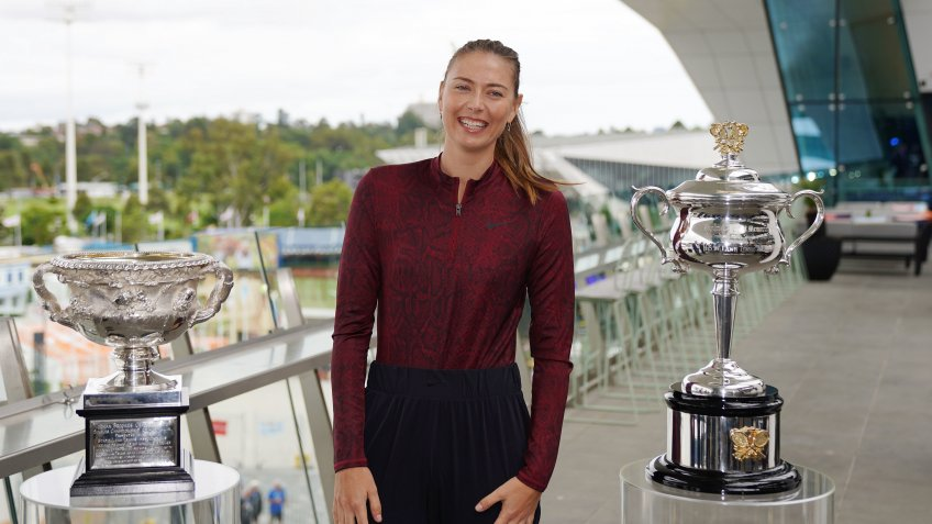Mandatory Credit: Photo by SCOTT BARBOUR/EPA-EFE/Shutterstock (10523859i)Maria Sharapova of Russia poses next to the Norman Brooks Challenge Cup (Men's) and Daphne Akhurst Memorial Cup (Women's) trophies during the 'one week to go' preview of the Australian Open 2020 at Melbourne Park in Melbourne, Victoria, Australia, 12 January 2020.