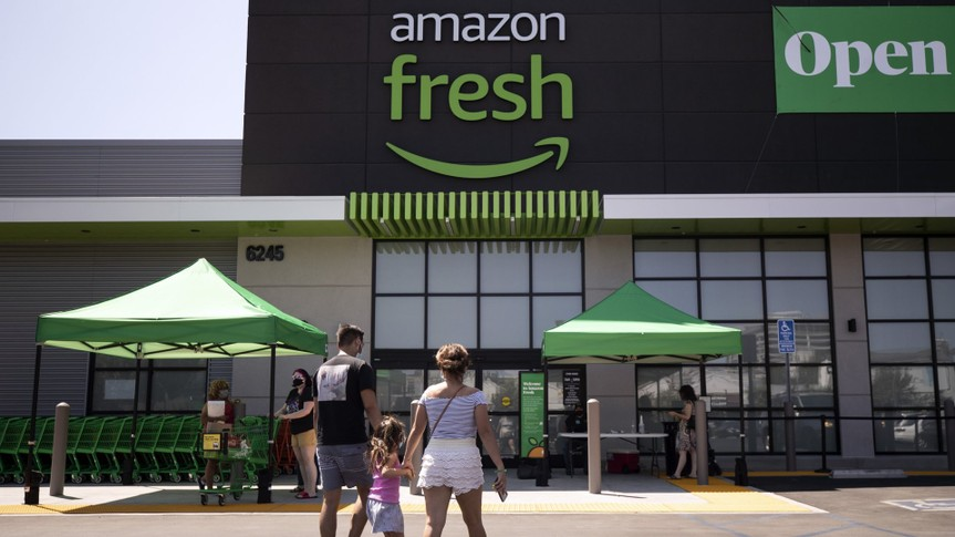 Mandatory Credit: Photo by ETIENNE LAURENT/EPA-EFE/Shutterstock (10758920g)A family arrives at the Amazon Fresh supermarket in Woodland Hills, California, USA, 28 August 2020.