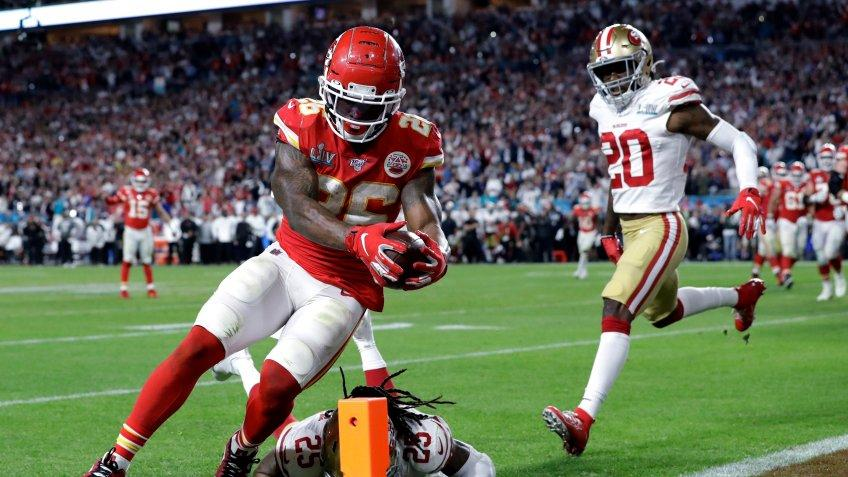 Mandatory Credit: Photo by Mark Humphrey/AP/Shutterstock (10735736a)Kansas City Chiefs' Damien Williams (26) scores a touchdown against the San Francisco 49ers during the second half of the NFL Super Bowl 54 football game in Miami Gardens, Fla.