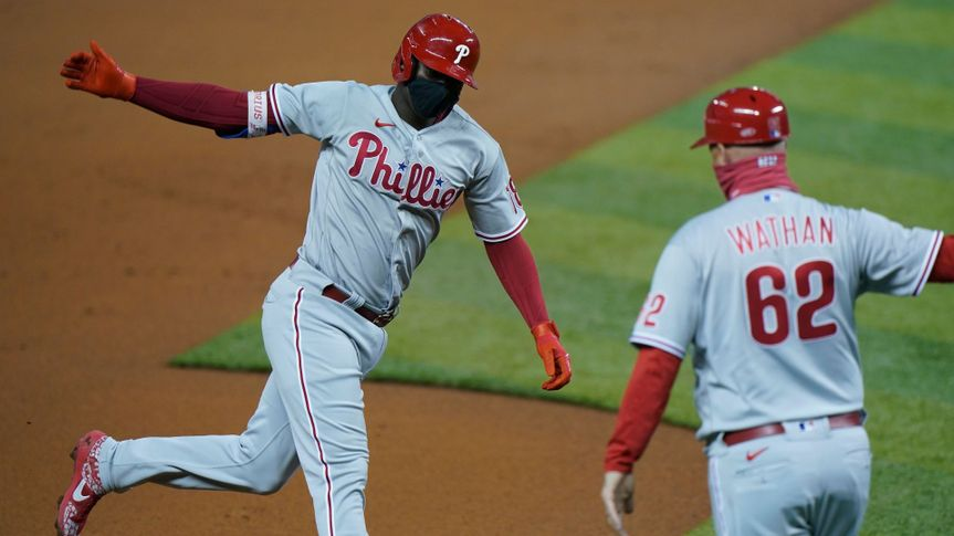 Mandatory Credit: Photo by Wilfredo Lee/AP/Shutterstock (10775027c)Philadelphia Phillies' Didi Gregorius, left, celebrates with third base coach Dusty Wathan as he rounds third base after hitting a grand slam, also coring Bryce Harper, J.