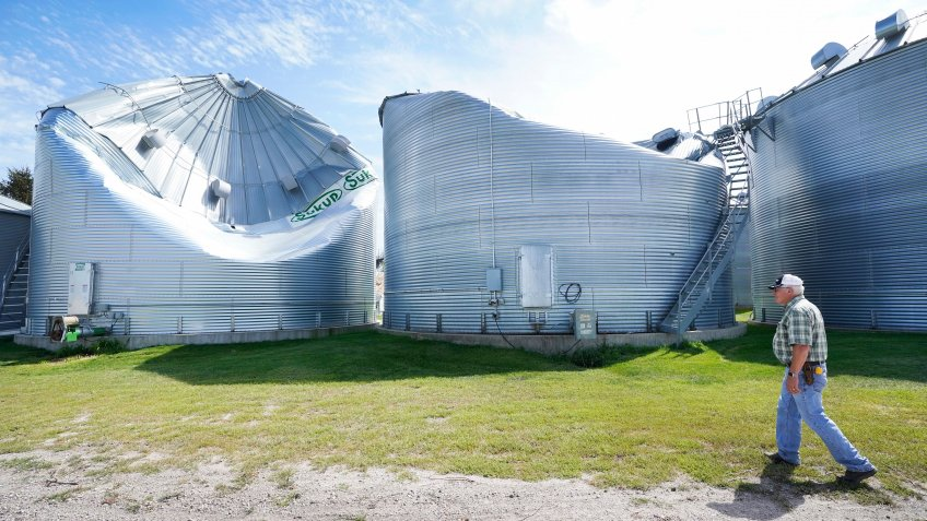 Mandatory Credit: Photo by Charlie Neibergall/AP/Shutterstock (10755267h)Rod Pierce looks at grain drying bins on his farm that were damaged in the derecho earlier this month, near Woodward, Iowa.