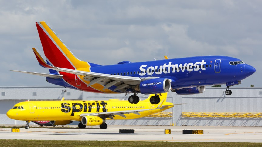 Southwest plane landing with Spirit plane in the background